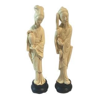 Oriental Man and Women Carved Figurines - A Pair