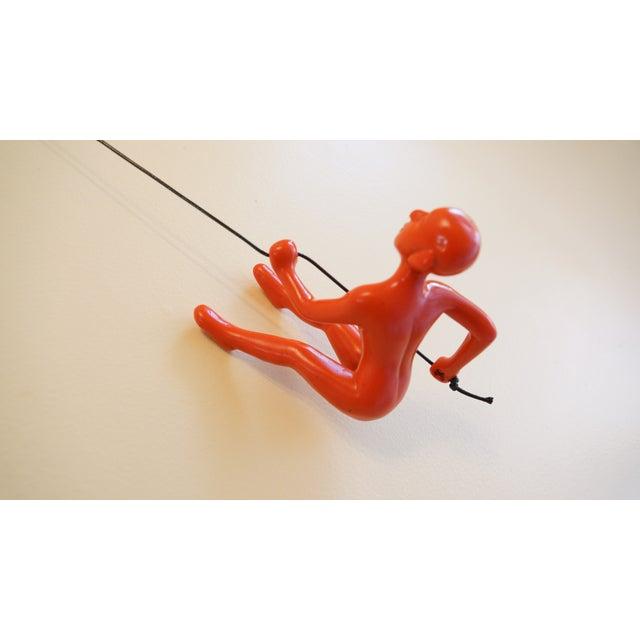 Image of Orange Position 2 Climbing Man Wall Art