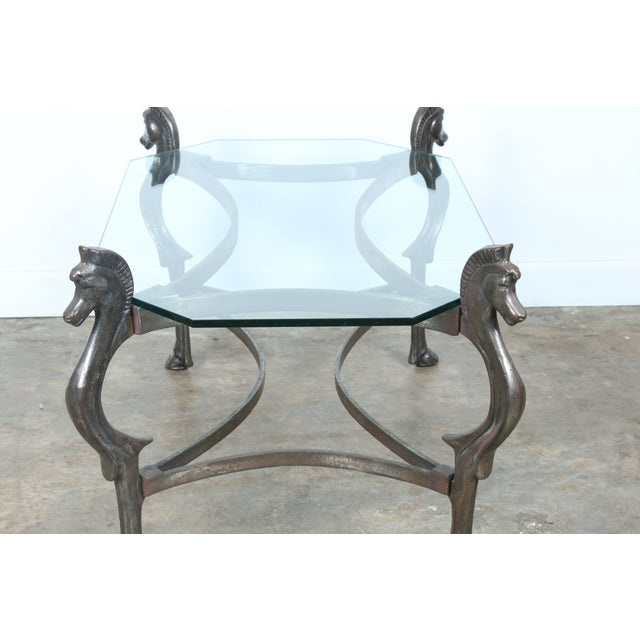 Wrought iron glass top horse coffee table chairish for Glass coffee table wrought iron legs