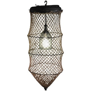 Pendant Light From Seltzer Bottle Inside Fish Trap