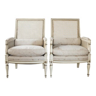20th Century French Louis XVI Painted Cane Bergeres Armchairs - a Pair