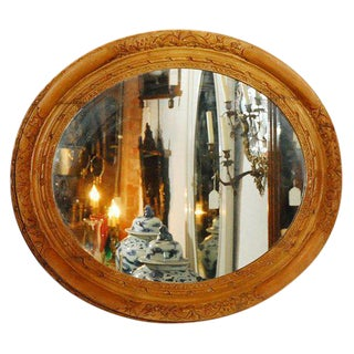 Mirror in Oval Carved Frame