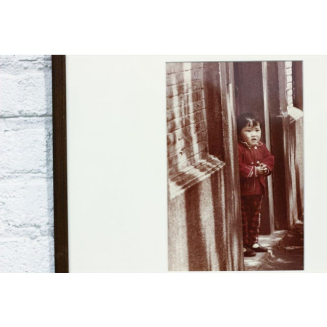 Image of Child in a Doorway Aged Photograph