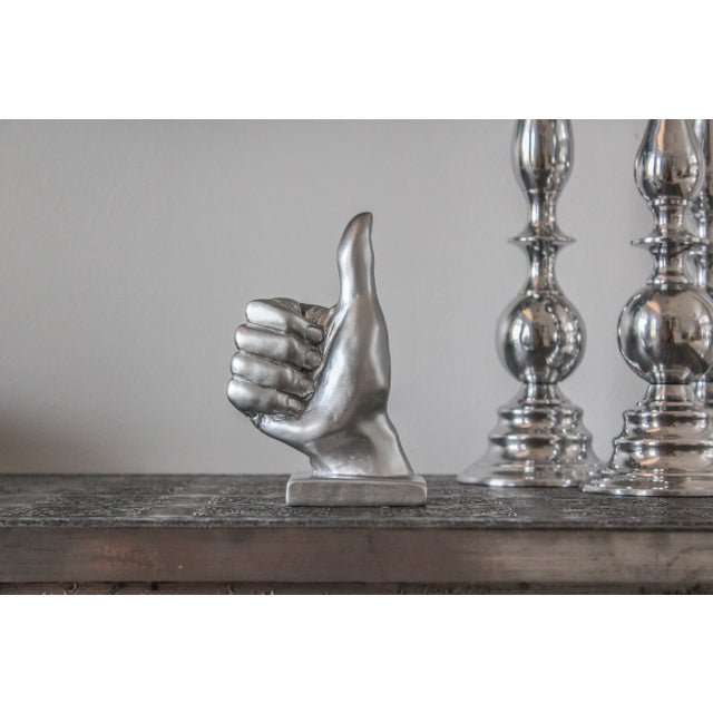 Image of Silver Thumbs Up Hand Symbol Sculpture