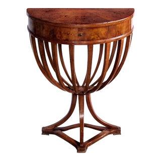 A shapely Italian Biedermeier style walnut single-drawer demilune console table