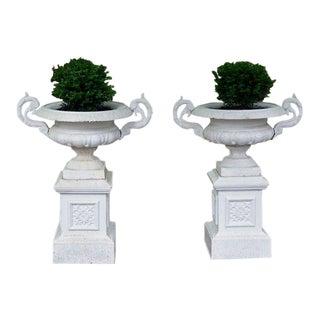 Garden urns on pedestals