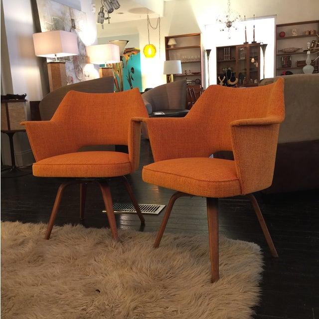 Image of Mid-Century Orange Swivel Chairs - A Pair