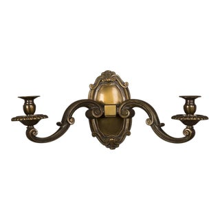 A massive Regence style bronze sconce with two lights and a shaped back plate from France c. 1920.