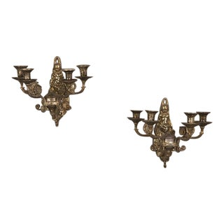 A pair of unusual Régence style four arm silver plated sconces from France c. 1895 with scenic back plates.
