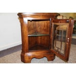 Image of Two-Piece Lighted Cherry Curio Corner Cabinet