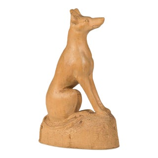 A charming naïve hand-made sculpture of a dog carved from a single piece of timber from England c. 1890