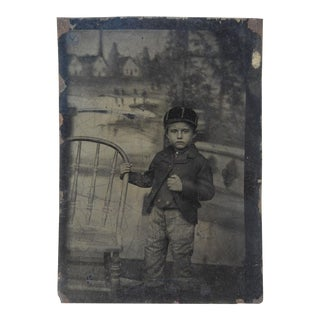 Tintype of Child with Elaborate Painted Backdrop