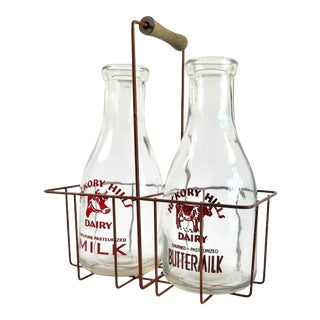 Two Vintage Milk Bottles and Metal Carrier With Wood Handle