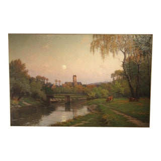 A Very Large Antique French Landscape Painting of a River Crossing a Village at Sunset, Circa 1905