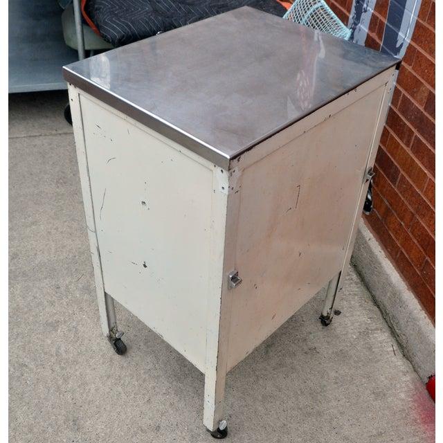 Image of Vintage Metal Cabinet on Wheels
