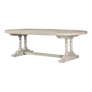 Oval painted dining table from Italy having two handsome turned column legs joined by a stretcher along with a decorative pattern in the side