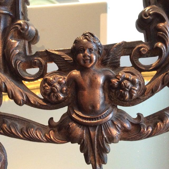 Image of Antique Cast Iron Cherub Mirror