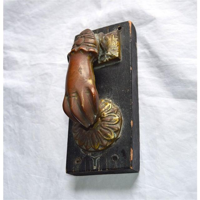 Image of Bronze Hand & Ball Door Knocker