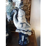 Image of Woman on Heron Porcelain Statue
