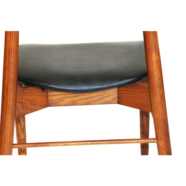 Image of Mid Century Teak Wingback Chairs - A Pair