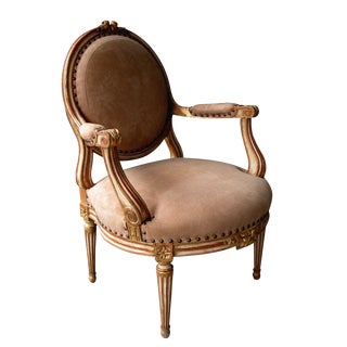 A Large-Scaled French Louis XVI Style Ivory Painted and Parcel Gilt Oval Back Open Armchair