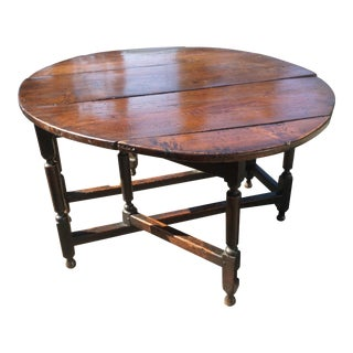Early 18th Century Dark Oak Gate Leg Table