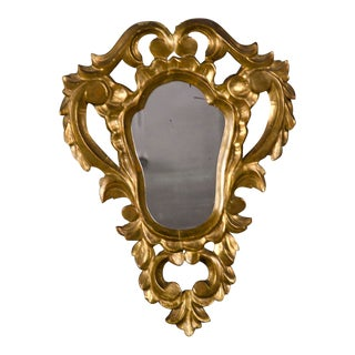 A Rococo style gold leaf mirror frame enclosing the original mirror glass from Italy c.1850 (14″w x 18 1/2″h)