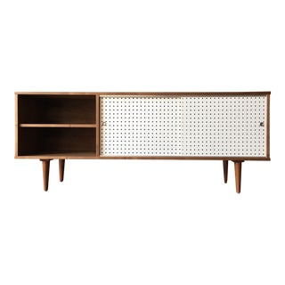Custom Walnut credenza with perforated doors and metal track