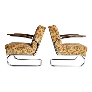 Pair of Chairs with Curved Chrome Legs