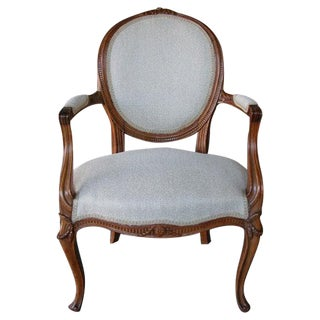 An English George III Carved Beechwood Armchair in the French Taste