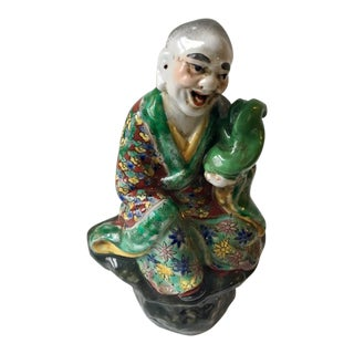 Chinese Immortal Holding a Foo Dog Figurine