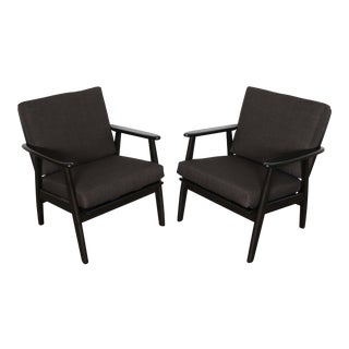 Newly upholstered stained beech midcentury lounge chairs