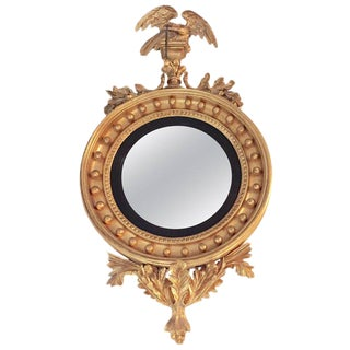 Federal Style Convex Mirror Ebony and Gilt Adorning an Eagle Winged Crest