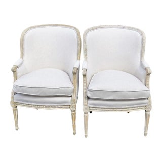 Distressed Cream Painted Carved Bergeres - A Pair