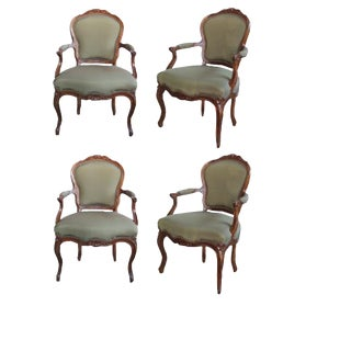 An Well-Carved Set of 4 French Louis XV Style Walnut Open Armchairs