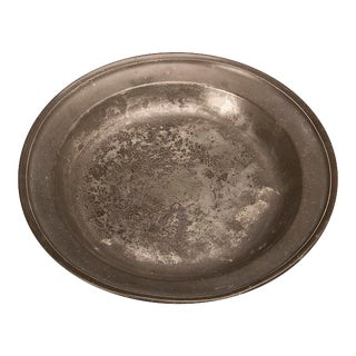 A large flat bottom pewter platter or bowl from England c. 1820