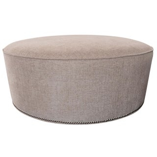 Neutral Round Ottoman with Nailhead Trim