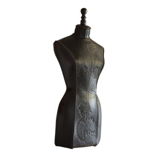 Hand tooled leather mannequin by Georgina Brett-Chinnery
