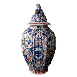 A Massive Dutch Polychromed Tinglazed Delftware Lobed Urn with Lid Surmounted by a Regal Lion