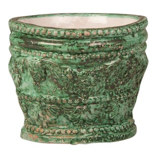 A glazed ceramic green cachepot with raised decoration from the Solimene workshop in Italy.