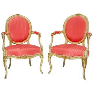 Louis XV Period Painted Pink and Parcel Gilt Fauteuils - a Pair
