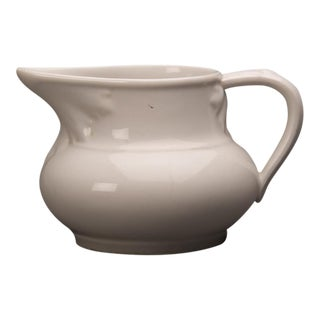 White glazed earthenware pitcher with a handle from Belle Époque France c.1890.