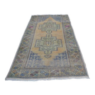 Faded Vintage Wool Turkish Rug - 4′6″ × 8′7″