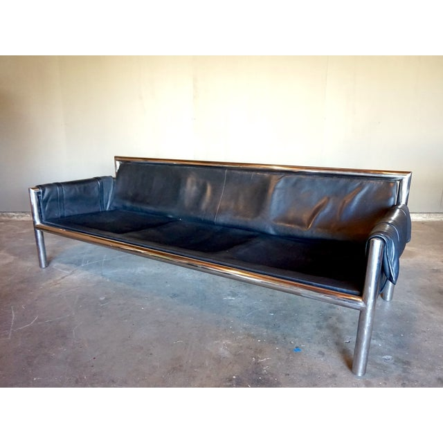architectural chrome and worn leather sofa chairish