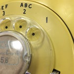 Image of Western Electric Yellow Rotary Dial Telephone