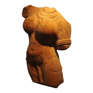 An Indian Pink Sandstone Torso of a Female Deity