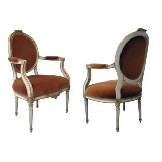 A Pair of Gustavian Style Ivory Painted & Parcel Gilt Armchairs