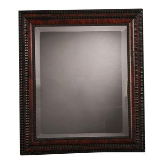 A Dutch faux tortoise and ebonized wood frame enclosing the original beveled mirror glass from Holland c. 1870 (23″w x 26″h)