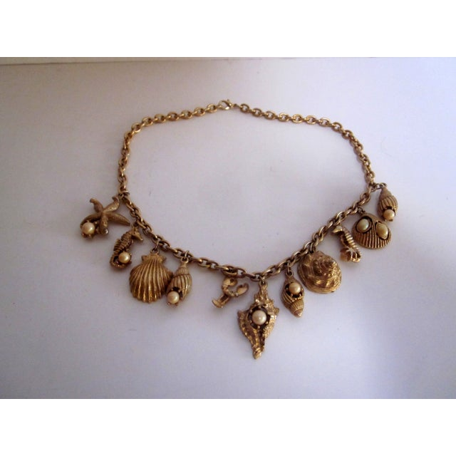 Image of Gold tone Sea Coastal Beach Shell Charm Necklace