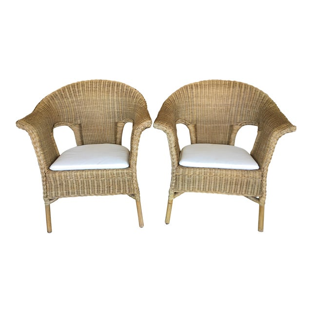 Stackable Wicker Arm Chairs & White Cushions - A Pair - Image 1 of 11